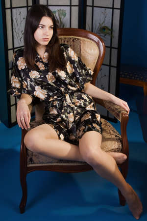 Attractive lady in a blue colors boudoir Stock Photo - 9128296