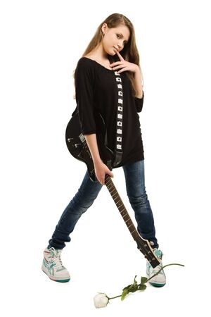 Teenager girl with electric guitar against white background Stock Photo - 9126200