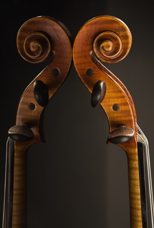 concerto: Close-up picture of the old italian violin over black Stock Photo