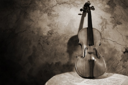 Picture of the old italian violin on a wall background Stock Photo