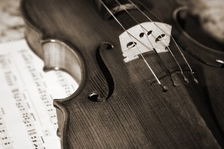 Close-up picture of the old italian violin witn score Stock Photo - 9128300