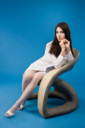 A pretty young nurse sitting in a chair photo