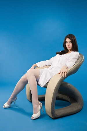 A confident young nurse sitting in a chair photo