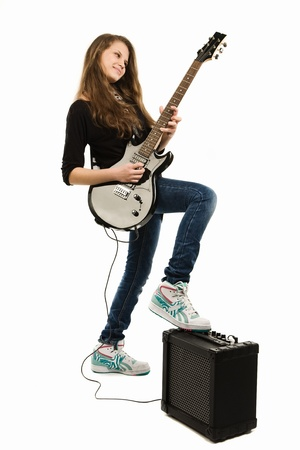 girl playing guitar: Teenager girl playing guitar against white background