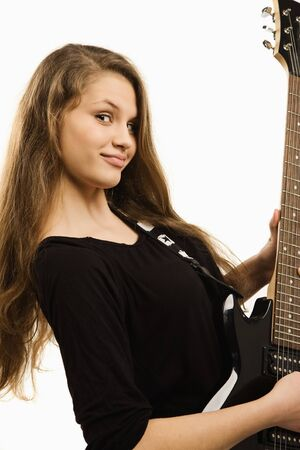 Teenager girl playing guitar against white background Stock Photo - 9137638