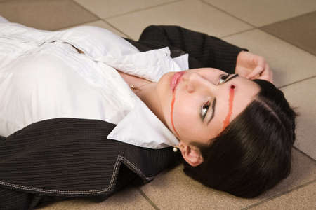 Face of the killed businesswoman in a office Stock Photo - 9137778