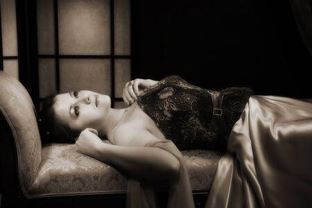 Elegant aristocratic lady in a luxurious boudoir photo
