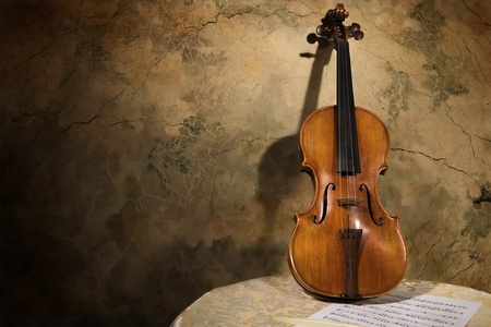 violas: Picture of the old italian violin on a wall background Stock Photo