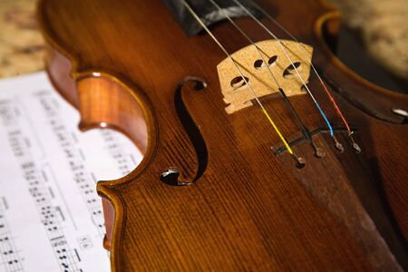 Close-up picture of the old italian violin witn score photo