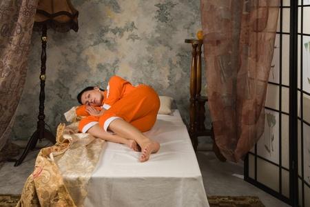 Sensuality brunette asleep in a luxury bedroom Stock Photo - 9201887