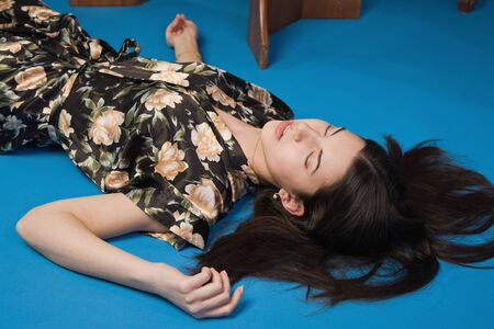 Sensuality brunette lying on the floor in a luxury room Stock Photo - 9201888