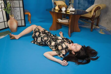 Sensuality brunette lying on the floor in a luxury room