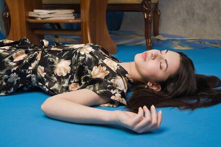 Sensuality brunette asleep in a luxury bedroom   photo