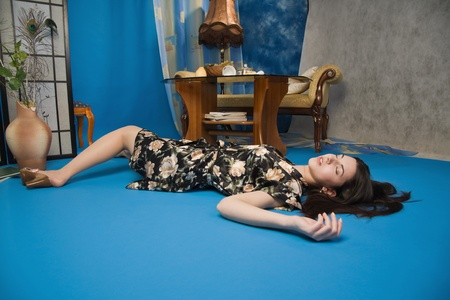 Sensuality brunette lying on the floor in a luxury room photo