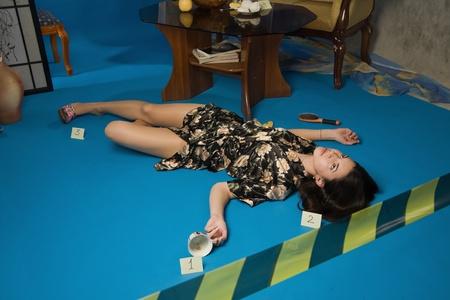 murder: Lifeless brunette in a dressing gown lying on the floor