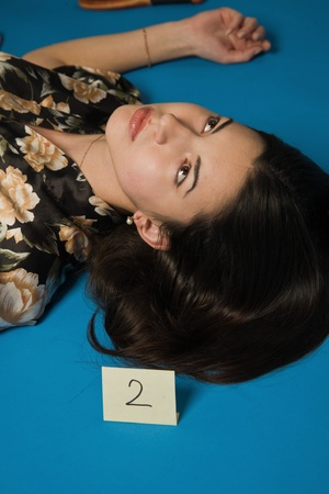 Lifeless brunette in a dressing gown lying on the floor Stock Photo - 9201879