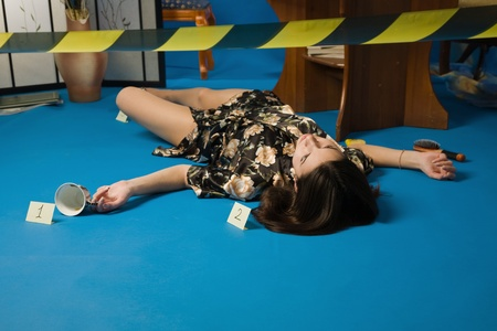 Lifeless brunette in a dressing gown lying on the floor Stock Photo - 9201875