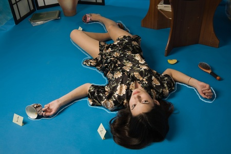 Poisoned brunette in a dressing gown lying on the floor Stock Photo - 9201874