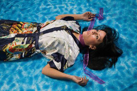 Crime scene: young strangled woman lying on the floor Stock Photo - 9201935