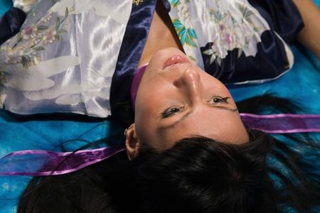 Crime scene: young strangled woman lying on the floor photo