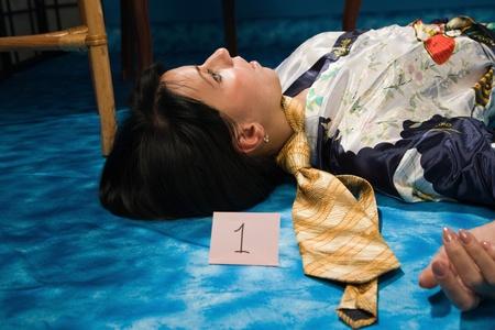 poisoned: Crime scene: young strangled woman lying on the floor