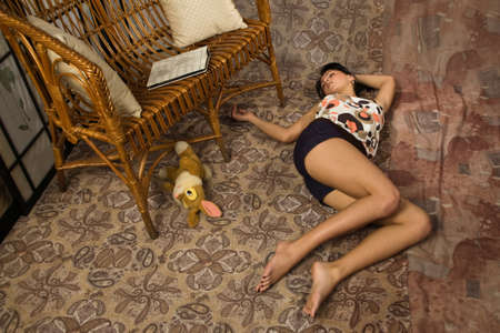 Sensuality brunette asleep on a floor in a luxury boudoir photo