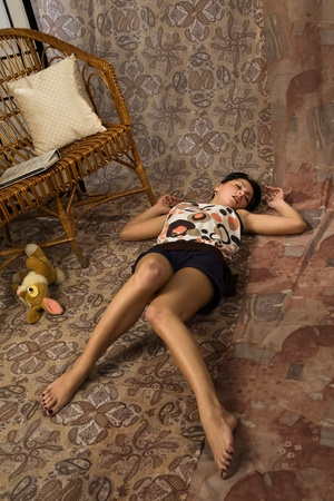 Sensuality brunette asleep on a floor in a luxury boudoir Stock Photo - 9201934