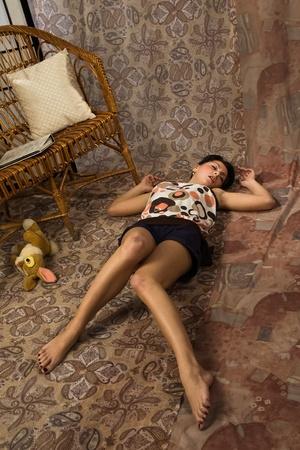 Sensuality brunette asleep on a floor in a luxury boudoir Stock Photo - 9201934