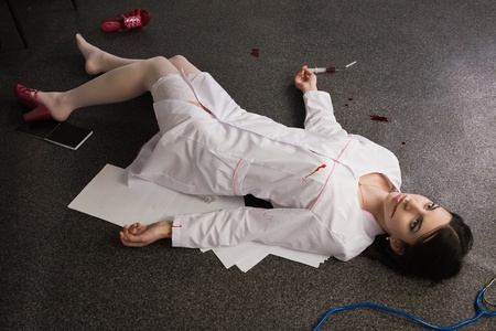Crime scene. Nurse lying on the floor Stock Photo - 9370038