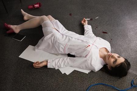 Crime scene. Nurse lying on the floor Stock Photo - 9370038