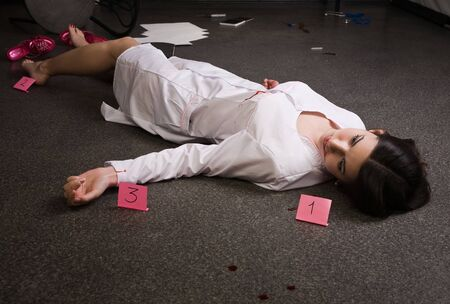 Crime scene. Nurse lying on the floor photo