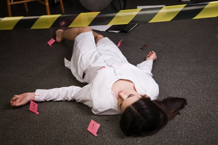 Crime scene. Dead nurse lying on the floor photo