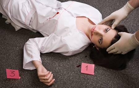 forensic medicine: Forensic expert collecting evidence in a crime scene