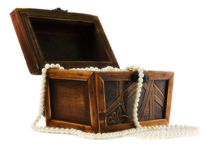 Wooden jewellery box packed with necklace and beads photo