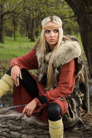karoling: Viking girl warrior with sword in a wood Stock Photo
