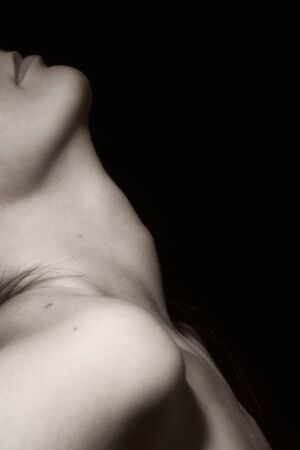 artistic nude: Closeup picture of the female neck (black and white) Stock Photo