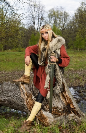 scandinavian people: Viking girl warrior with sword in a wood Stock Photo