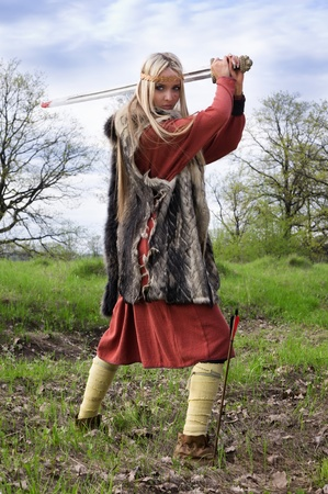 Viking girl warrior with sword fighted Stock Photo - 9780833