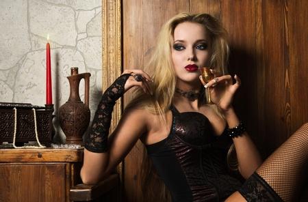 Portrait of the very pretty woman vamp photo