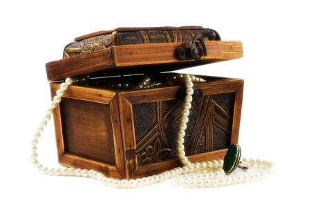Wooden jewellery box packed with necklace and beads Stock Photo - 9780709
