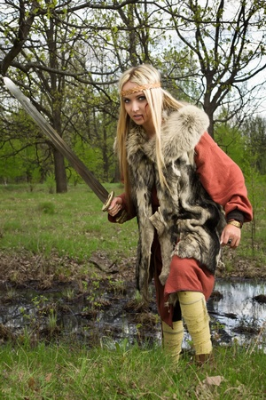 karoling: Viking girl warrior with sword in a fight Stock Photo