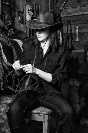rodeo cowgirl: Young cowgirl in the stables at the ranch