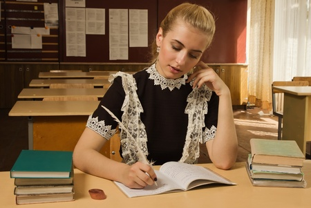 Portrait of confident school girl at her desk Stock Photo - 9780863