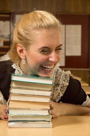 Portrait of happy school girl at her desk Stock Photo - 9780872