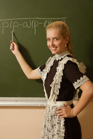 School girl on math classes finding solution Stock Photo - 9780870