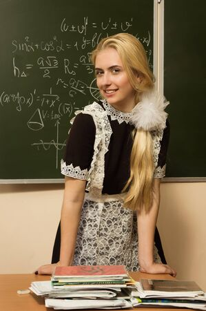 Confident school girl in a classroom photo