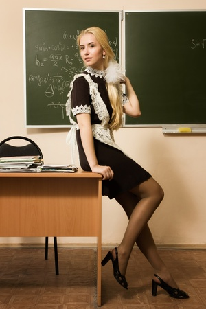 Portrait of smiling school girl in a classroom photo