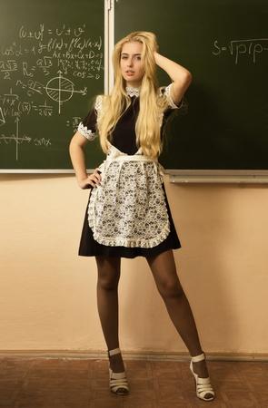 school uniform girl: Portrait of pretty school girl in a classroom