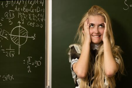 School girl on math classes finding solution photo
