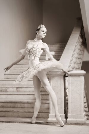 Portrait of the young ballerina in ballet pose photo